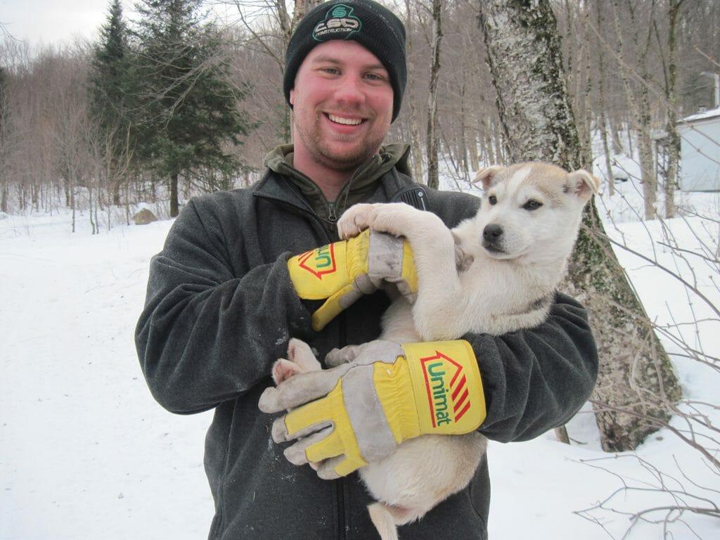 Joe and a sled dog puppy