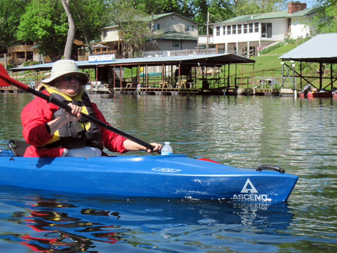 Kayaking past Branson boathouses