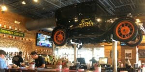 Model T above the bar at Ford's Garage