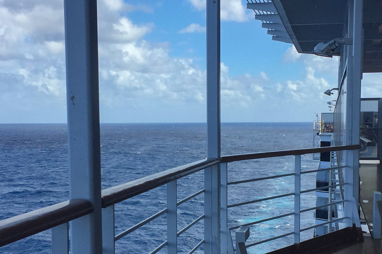Reflections in cruise ship window of open sea