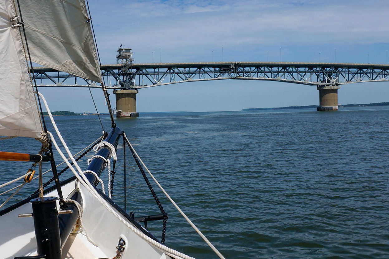 Sailboat approaching a bridge