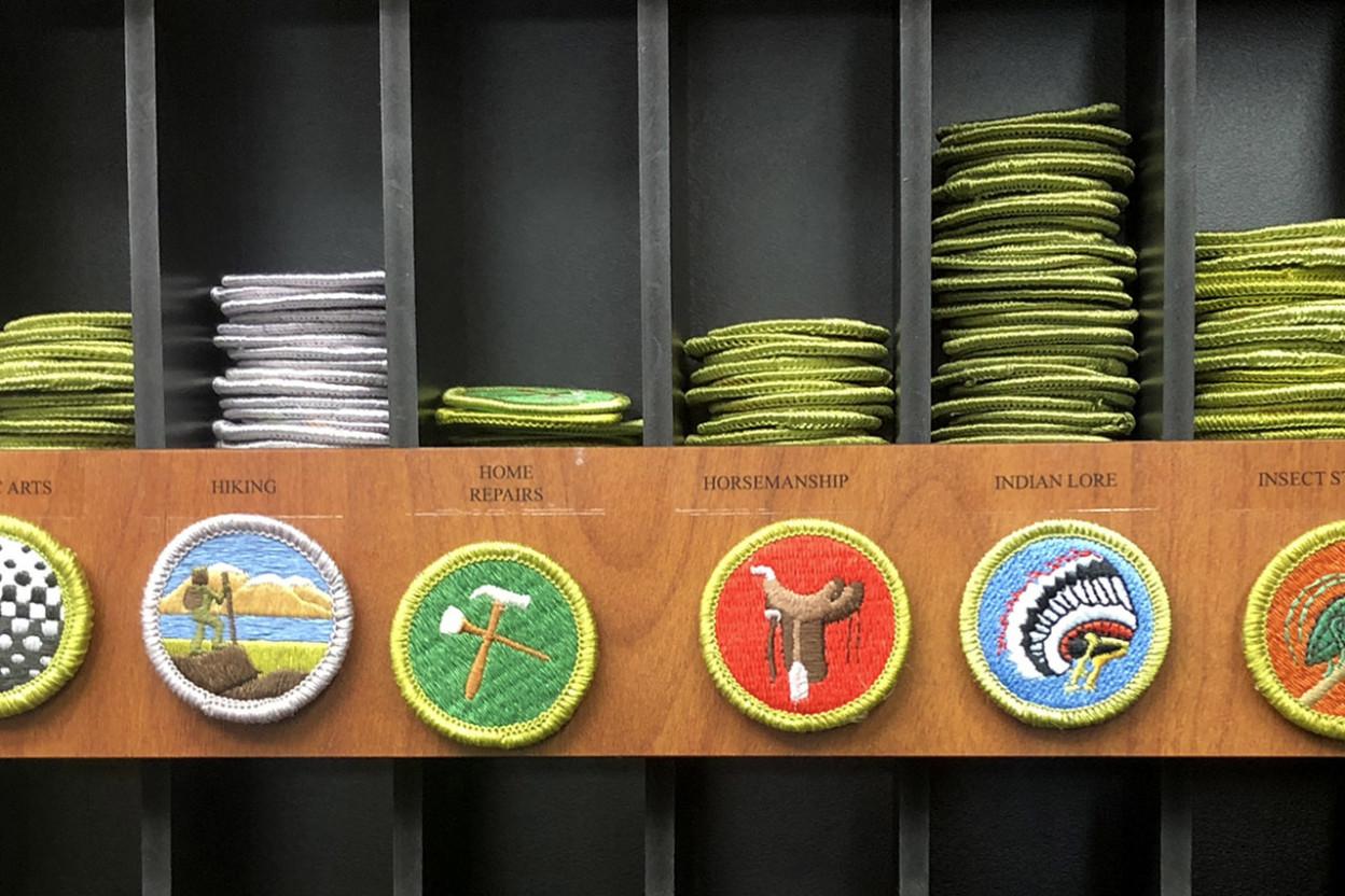 Boy Scout merit badges on a shelf