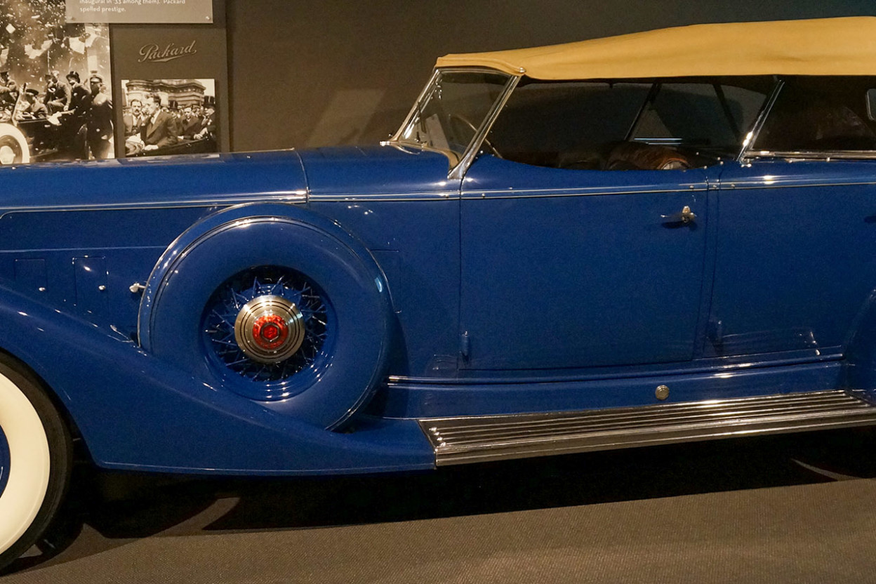 Long lean antique Packard in primary blue