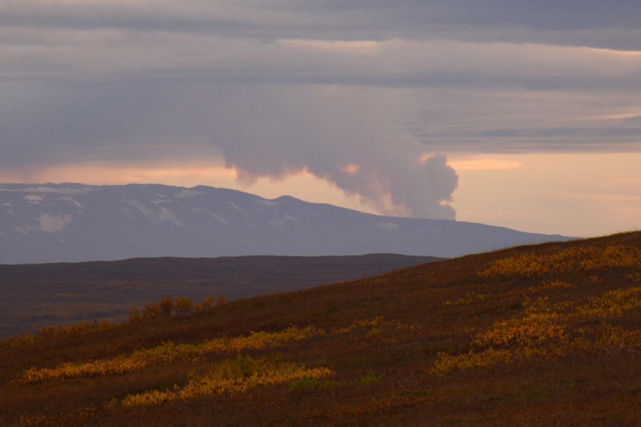 Smoke rising from an erupting volcano
